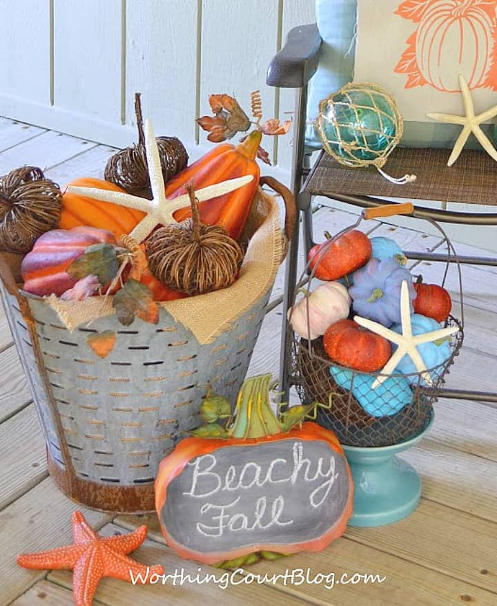 bucket and basket filled with a variety of pumpkins for a coastal fall vibe