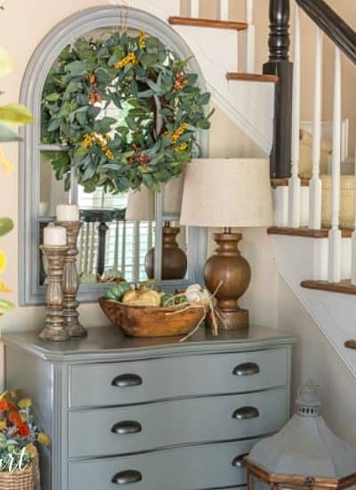 foyer with gray chest topped with fall decor