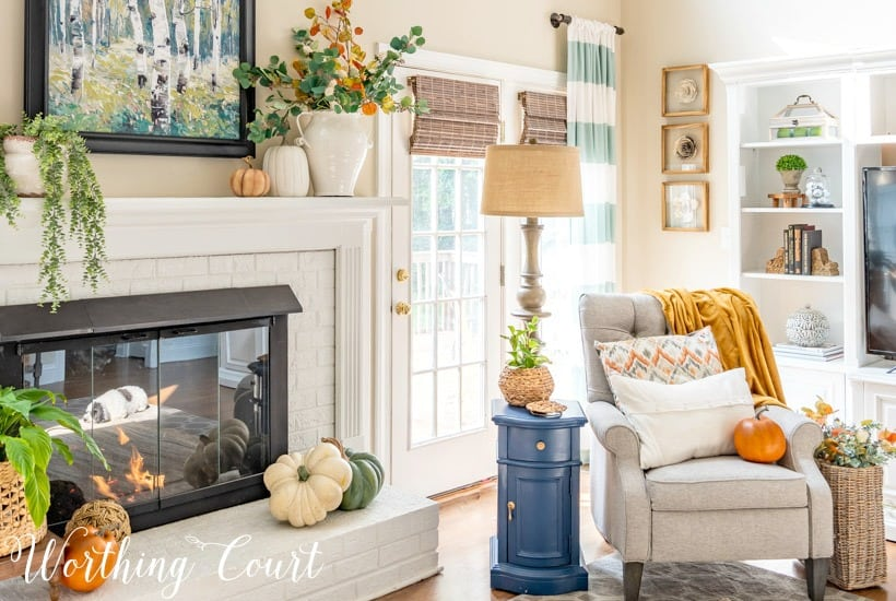 white brick fireplace decorated with soothing fall colors