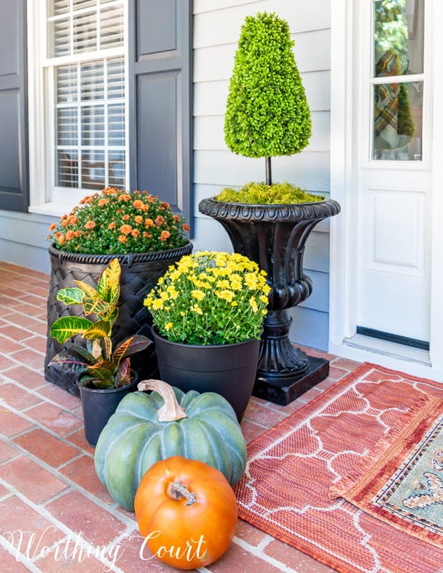 front porch decor ideas grouping mums in different planters