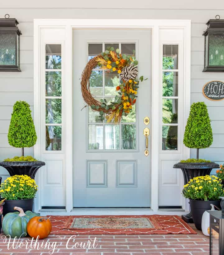 front porch decor ideas including a front door with a fall wreath