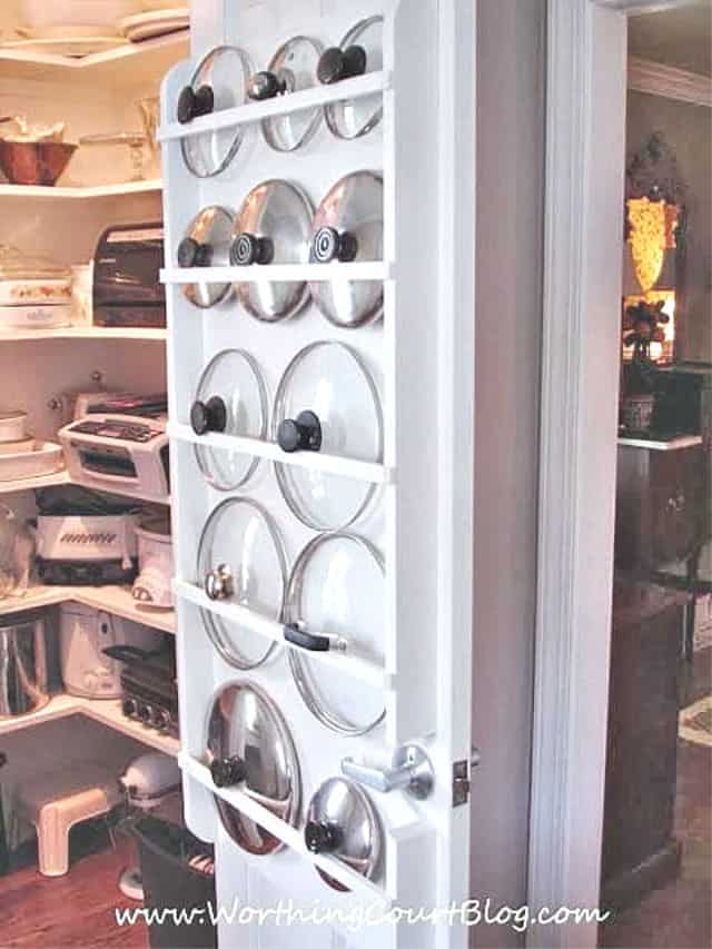 pot lids stored on the back of a pantry door