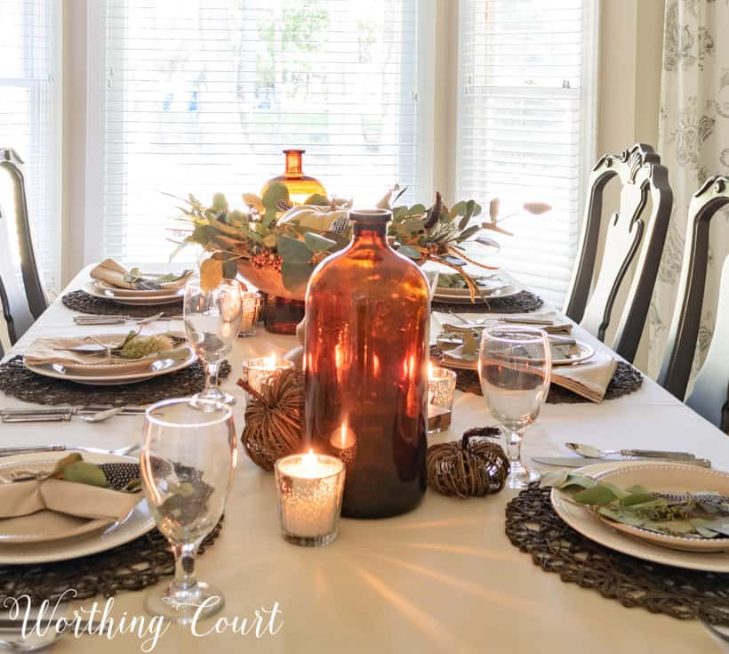 A neutral tablescape set for a holiday meal.