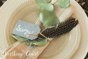 neutral place setting with eucalyptus napkin ring