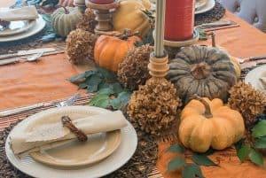 Thanksgiving centerpiece using pumpkins and dried hydrangeas