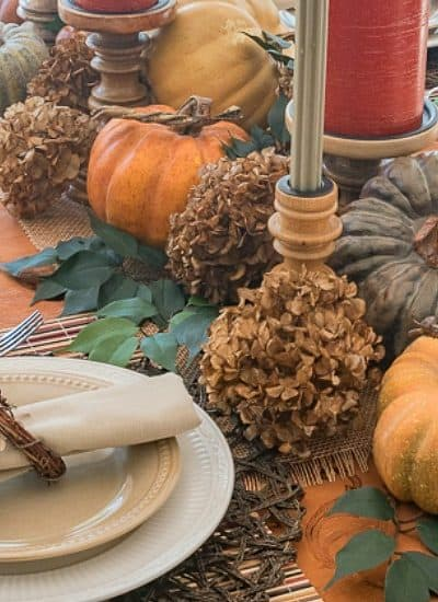 Thanksgiving centerpiece using pumpkins and dried hydrangeas