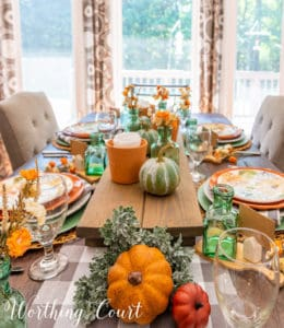 Thanksgiving tablescape using pumpkins and traditional fall colors