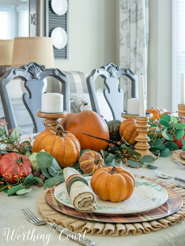 Thanksgiving table set with pumpkins and eucalyptus