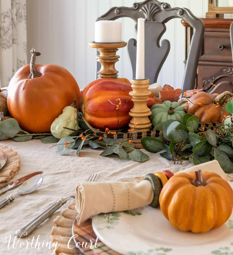 Thanksgiving table set with a linen tablecloth