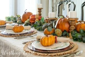 Thanksgiving tablescape with pumpkins and eucalyptus