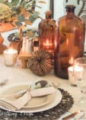 Thanksgiving table set with brown jugs and neutral dinnerware and linens