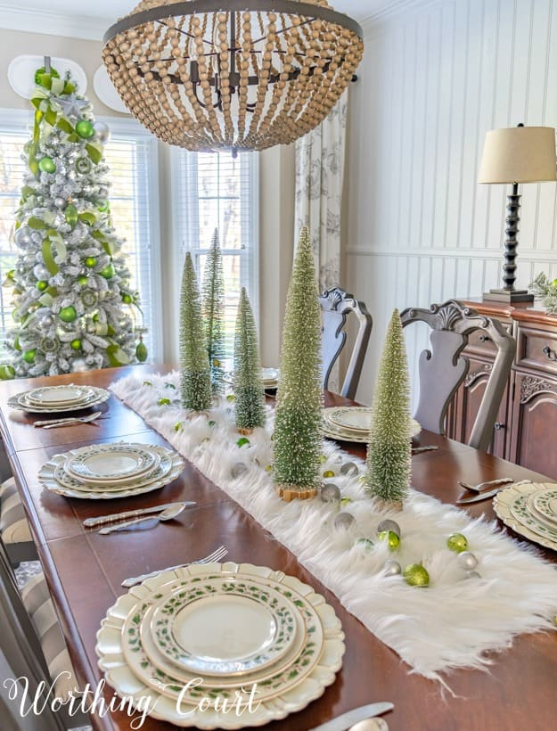 Christmas table centerpiece with a faux fur runner and bottlebrush trees
