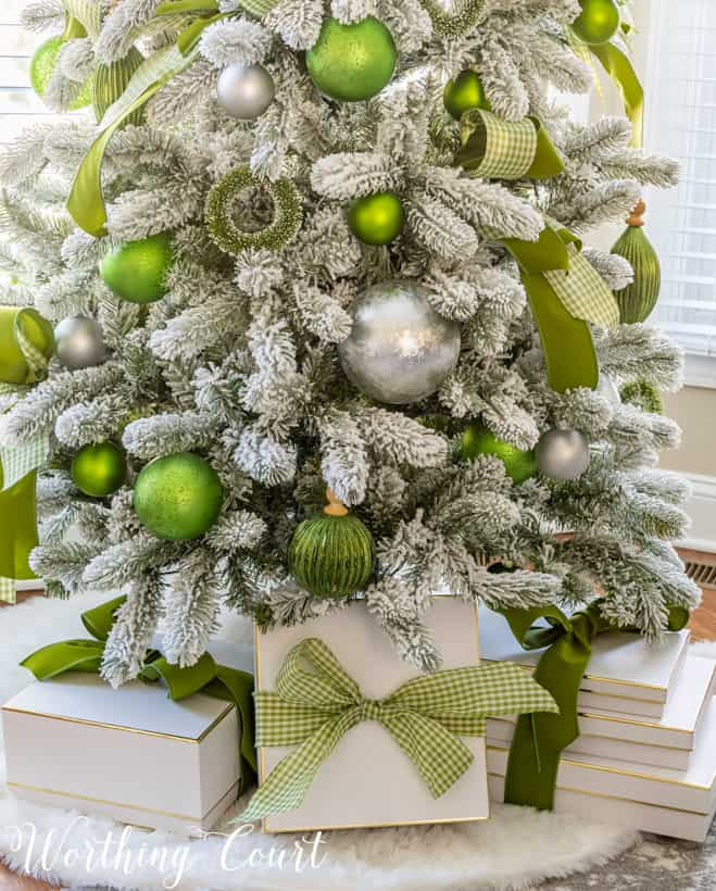 Flocked Christmas tree with green and silver ornaments