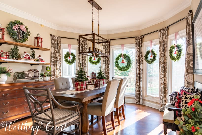 Dining room with red, white and plaid decorations.