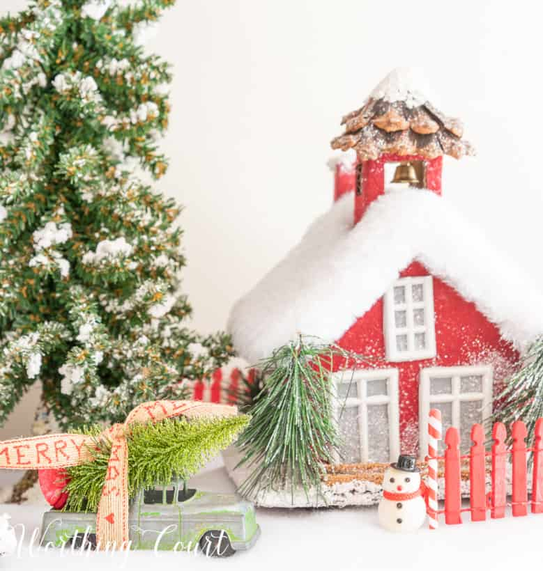 Red Christmas village house on a bed of snow