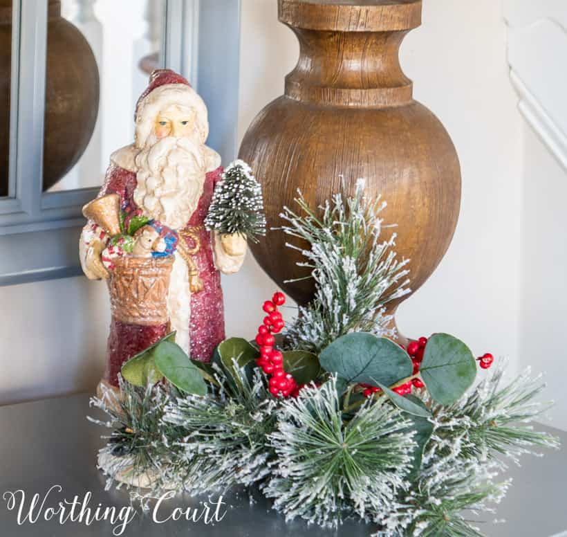 Christmas vignette with Santa figurine and faux greenery