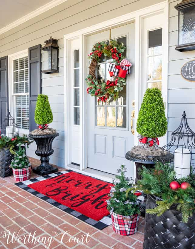 The welcoming red mat at the front door reads Merry & Bright.