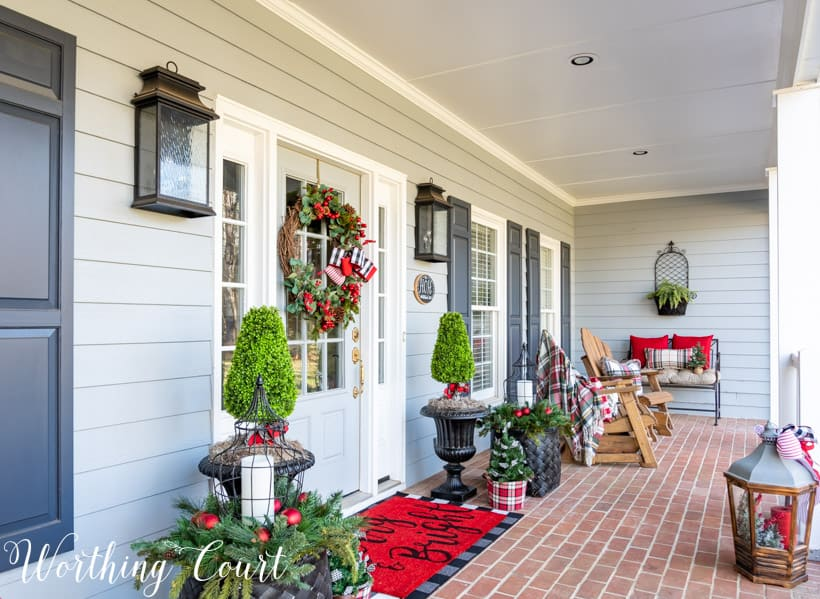 Front porch decorated for Christmas with black, white and red