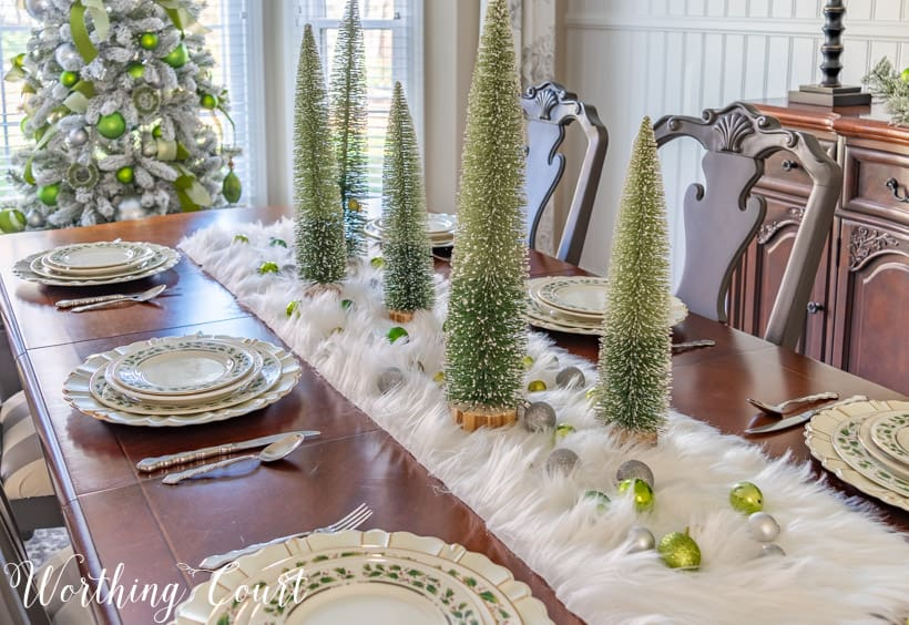 Christmas centerpiece with bottlebrush trees atop a faux fur runner