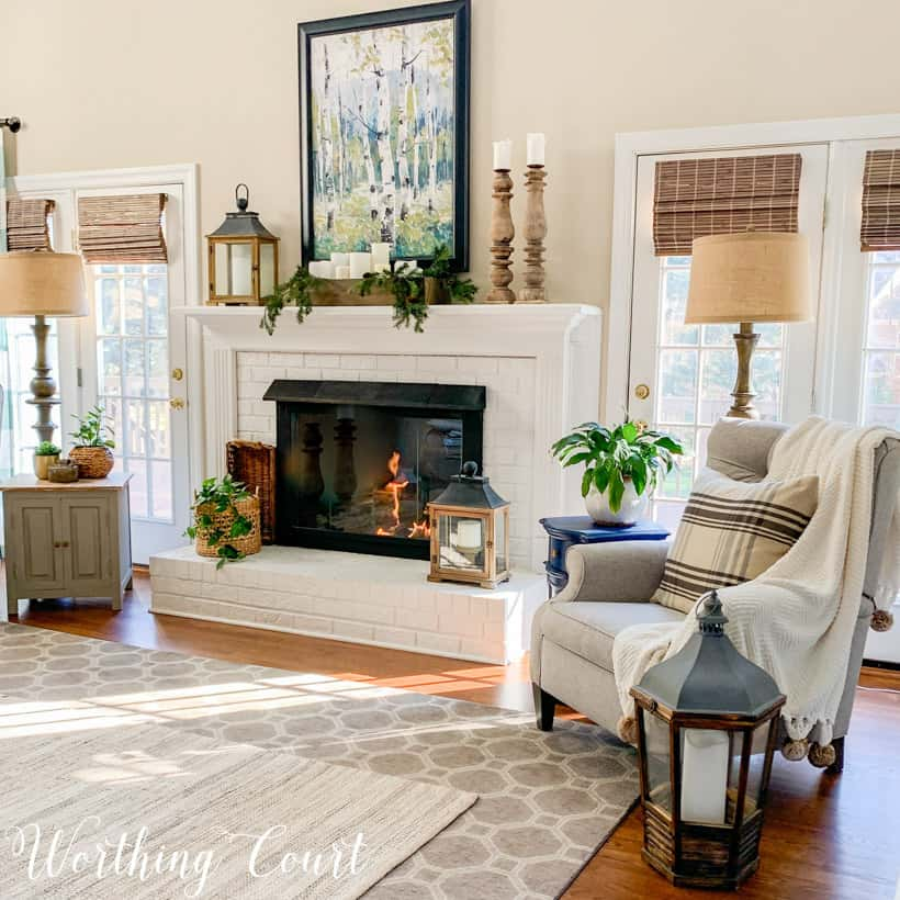 white brick fireplace with winter decor