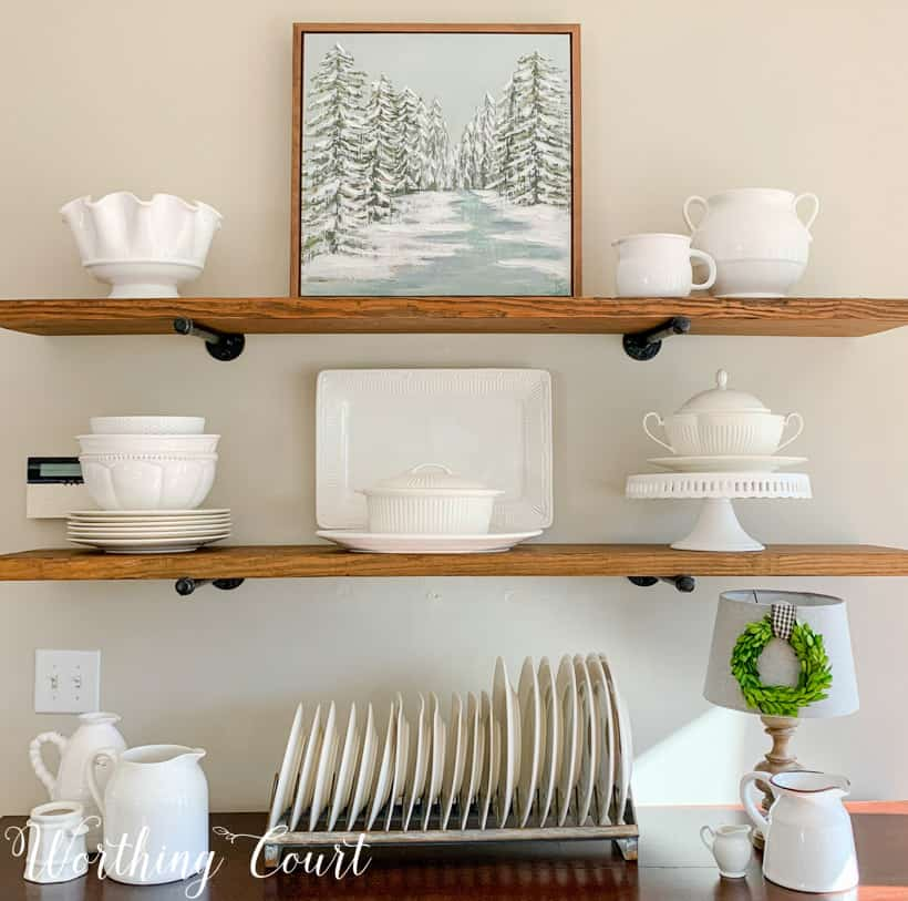 open shelves decorated for winter with white accessories