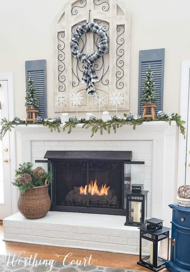 white brick fireplace decorated for winter