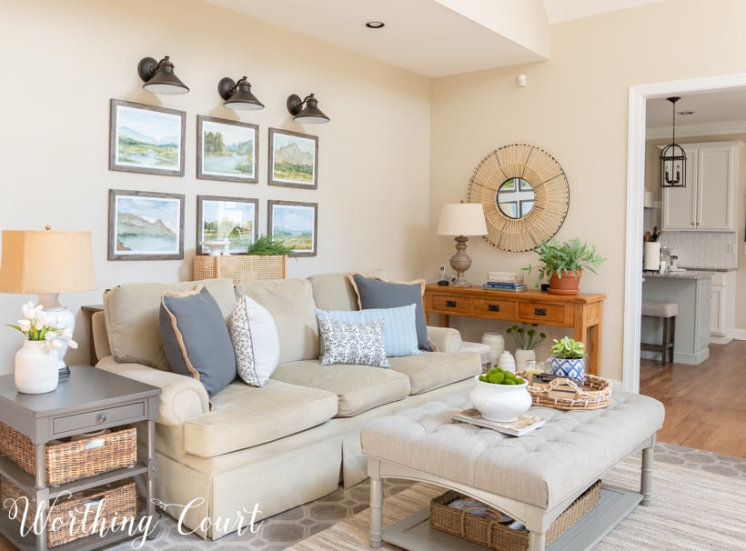 Neutral family room sofa and upholstered coffee table.