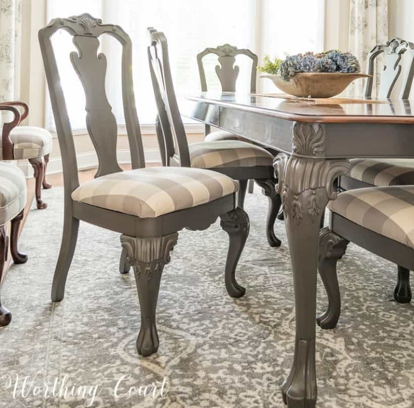 Dining room chairs painted with gray spray paint.