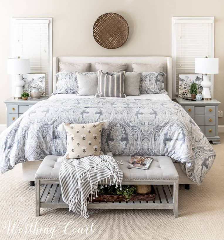neutral master bedroom bedding and furniture