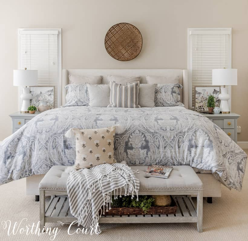 king size bed with mostly neutral bedding