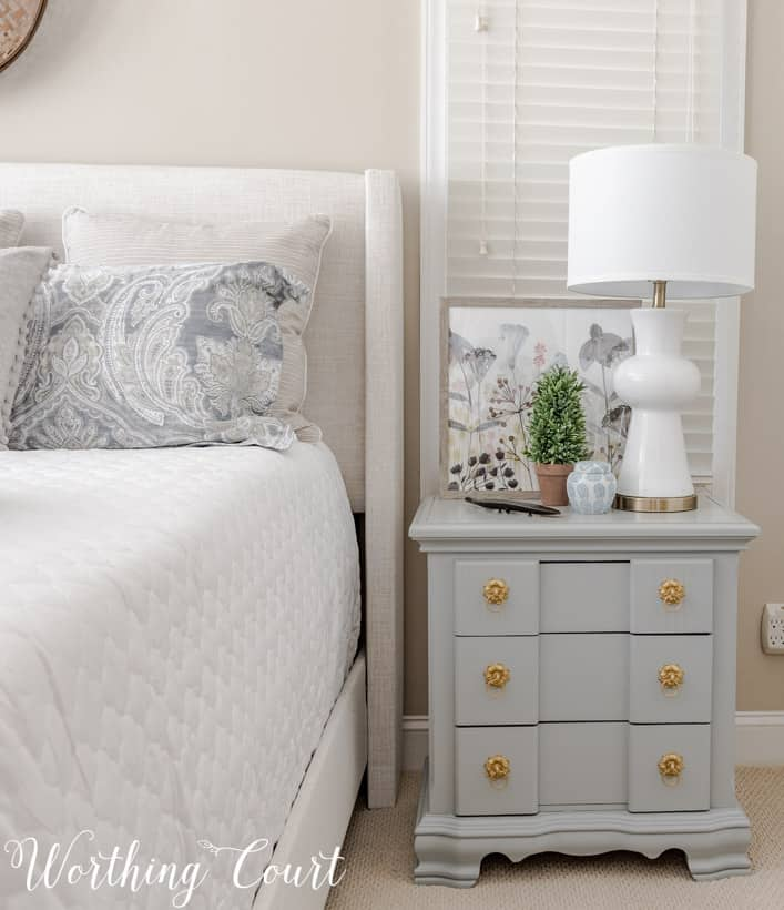 gray nightstand with white table lamp