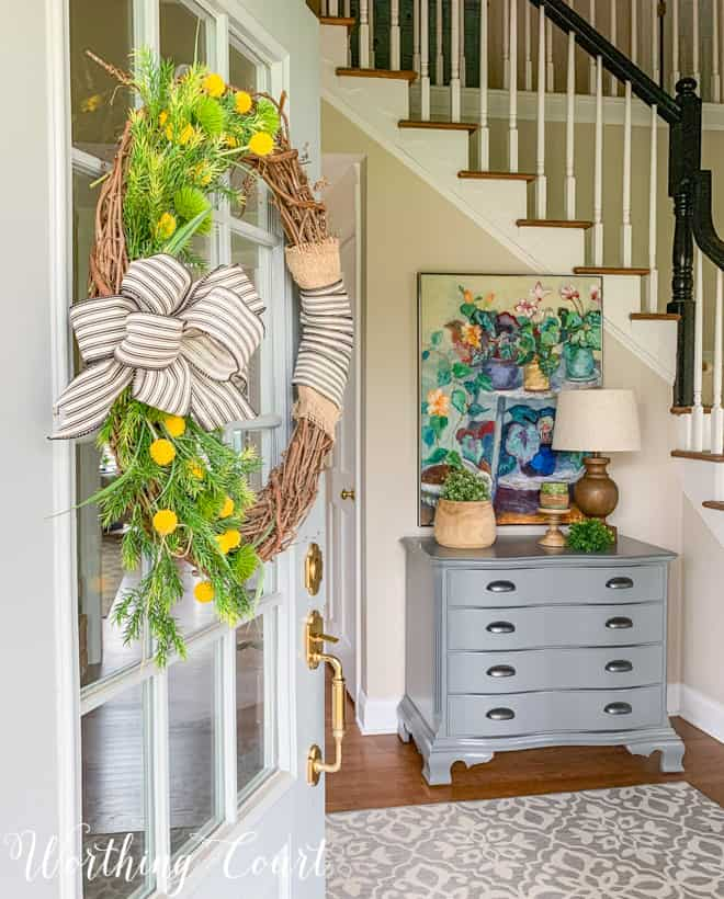 looking through a front door into a foyer with spring decor