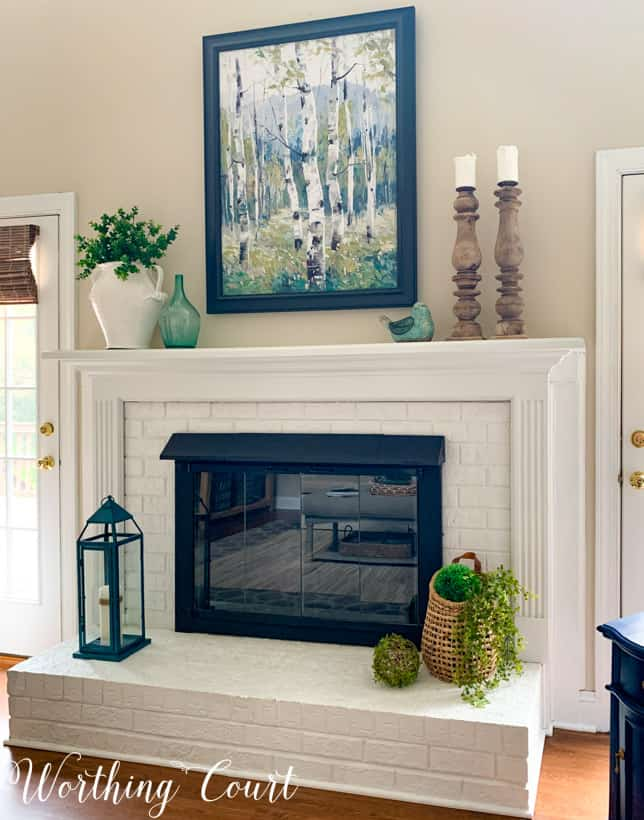 white fireplace showing negative space design