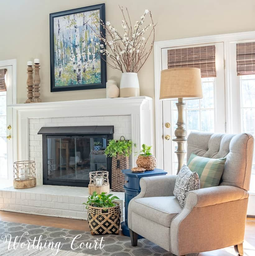 gray recliner beside white painted brick fireplace