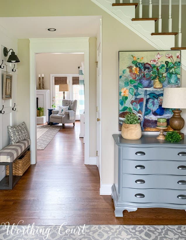 entryway with colorful painting looking through to family room