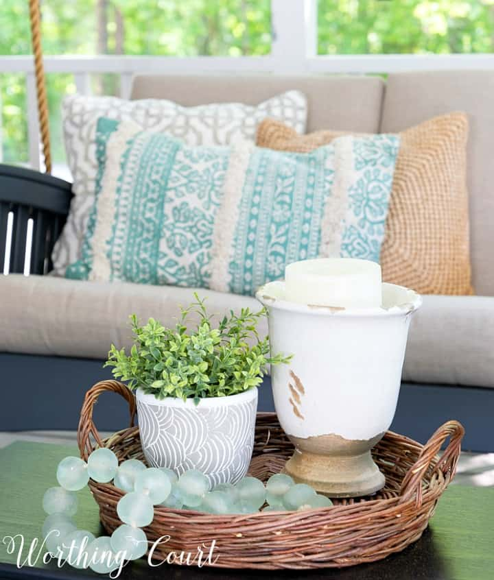 vignette in a wicker basket tray