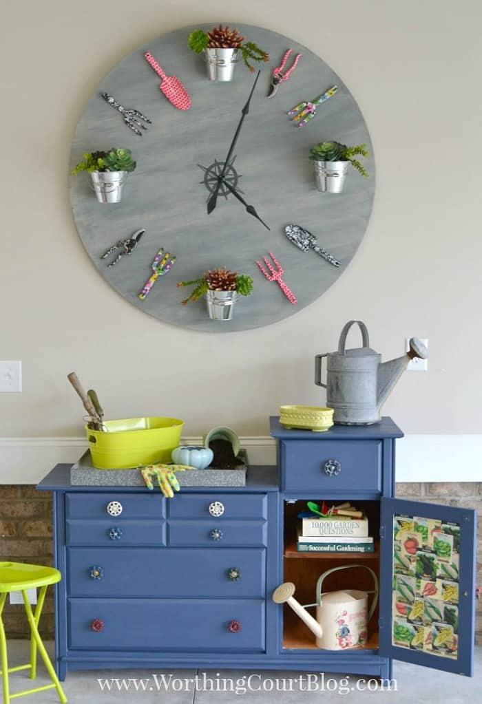 huge diy clock above blue garden bench