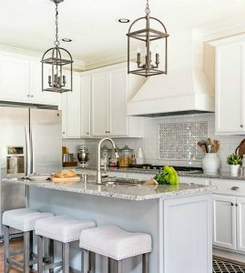 Kitchen with white cabinets example for negative space design