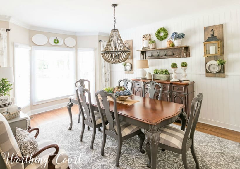 dining room with gray and wood table, chairs and sideboard