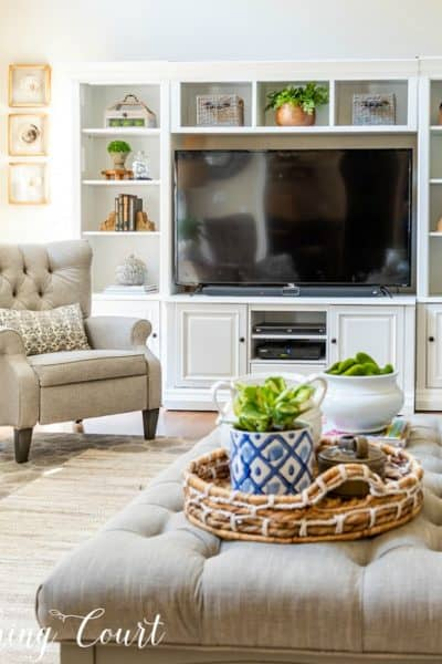upholstered table gray recliner and white entertainment center