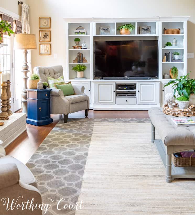 living room with white painted entertainment center and accessories