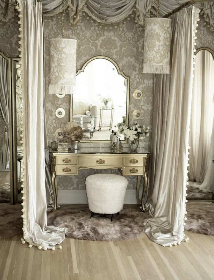 silver dressing table with mirror flanked by draperies