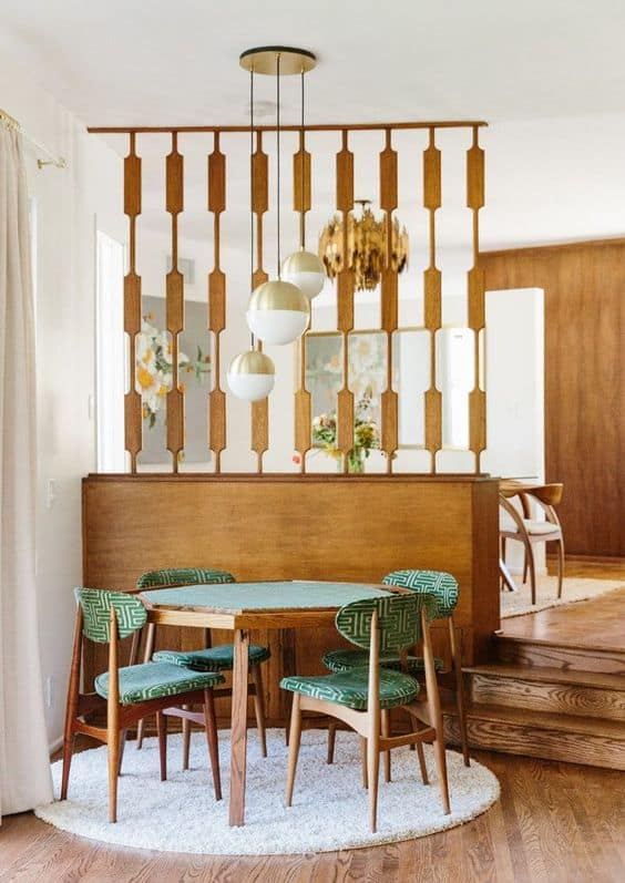 mid century modern dining set in front of room divider