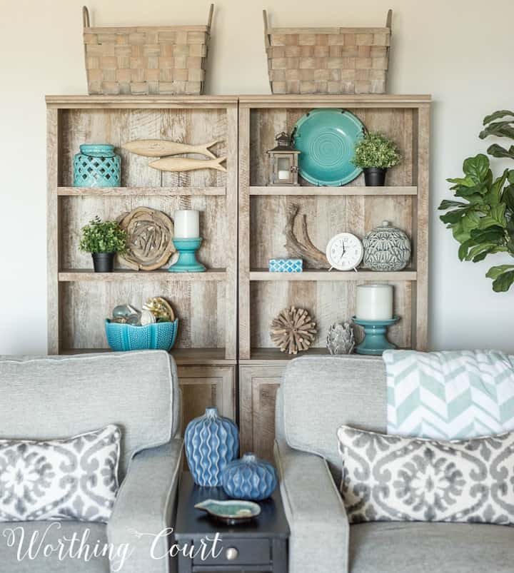 gray bookcases with beach style accessories