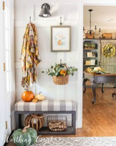 white board and batten wall with fall decor on hooks