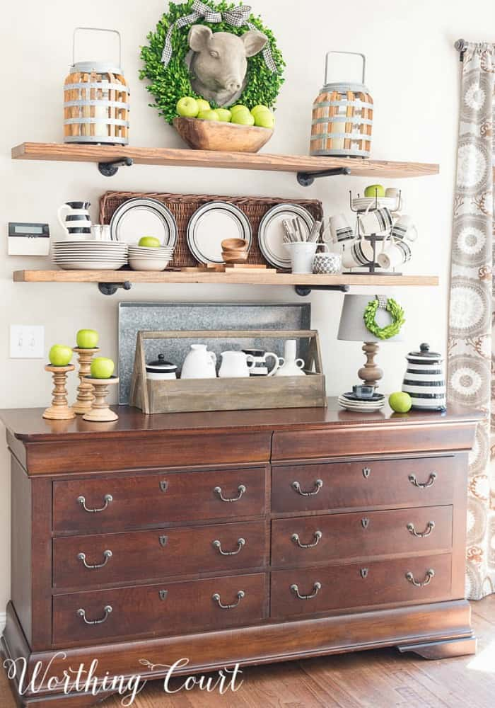 open shelves with fall decor above a sideboard
