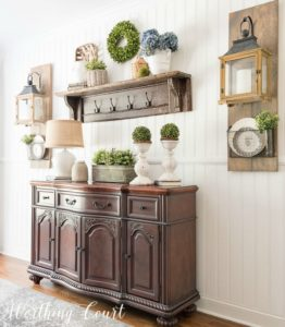 sideboard with shelf decorated with accessories