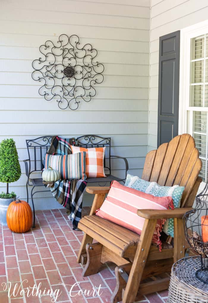 front porch with Adirondack gliders decorated for fall