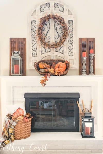 painted brick fireplace with fall decor
