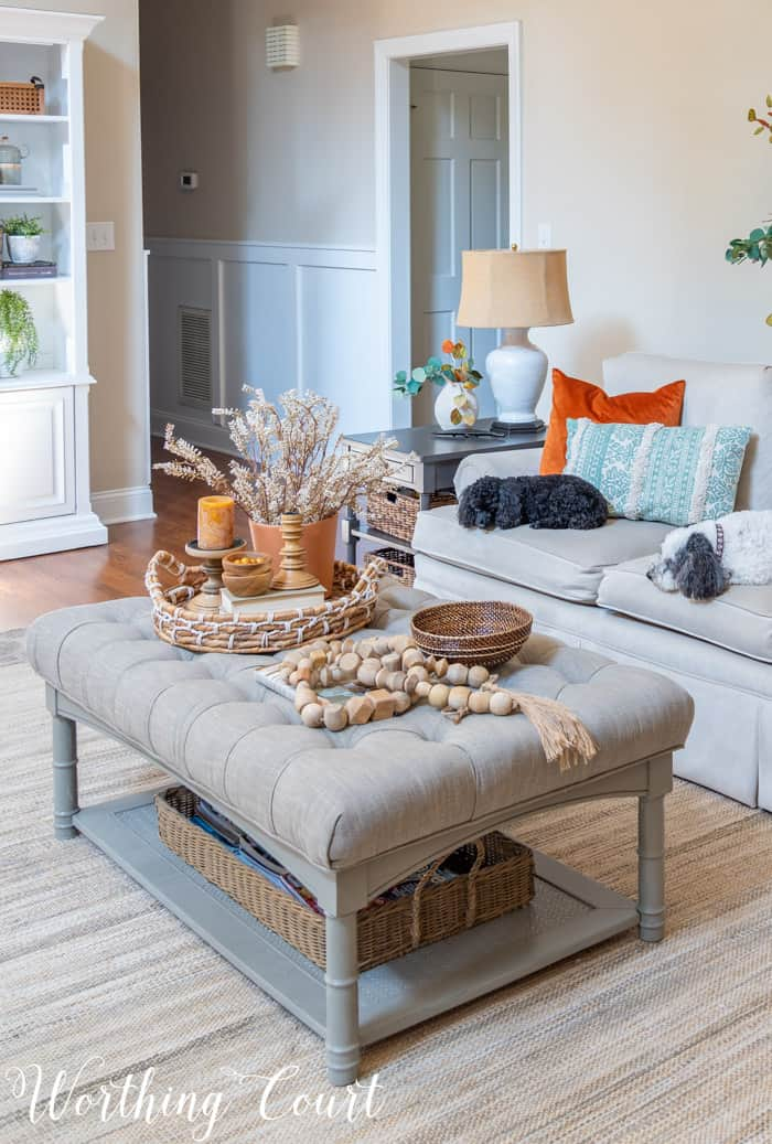 upholstered coffee table decorated for fall